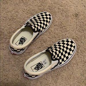 women slip on checkerboard vans